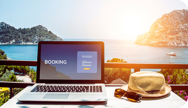 Laptop displaying a booking landing website with a background landscape of a big blue lake surrounded by mountains